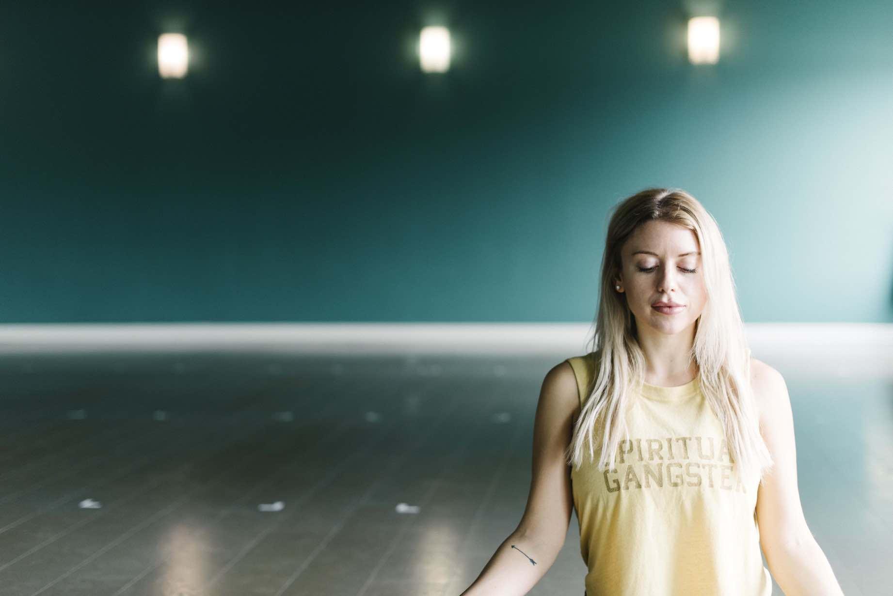 Girl meditating in a yoga studio