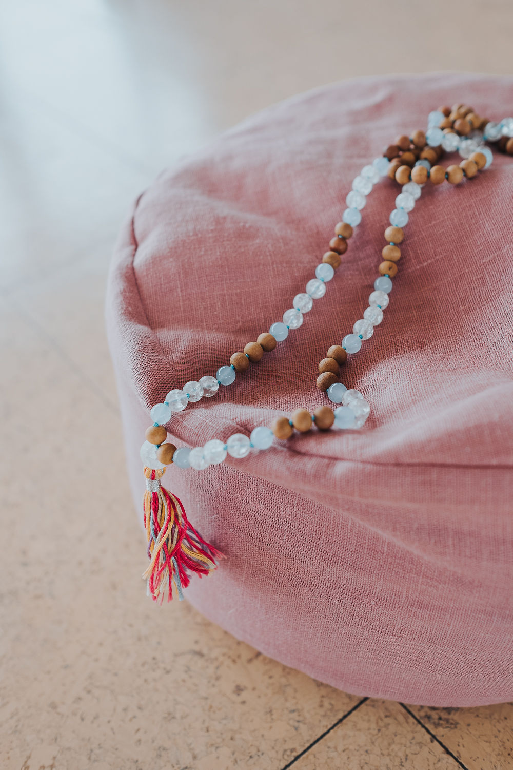 Meditation cushion and mala necklace
